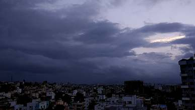 Time Lapse Of Clouds Over City
