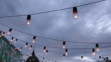 Low Angle Shot Of Light Bulbs On A Dark Sky
