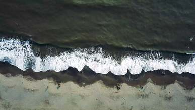 Aerial View of Waves Crushing to the Shore