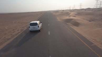 Car Driving Along The Dessert Highway