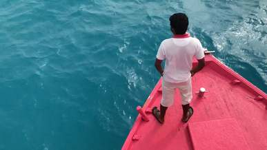Man Standing In Front Of A Boat