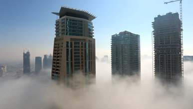 View of Buildings In A Foggy Atmosphere