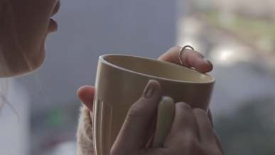 Woman Drinking Coffee And Talking With Her Boyfriend