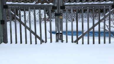 Snow Falling on Wooden Gate