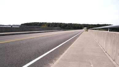 Cars Driving Over a Bridge