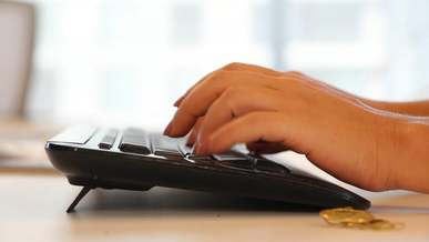 Woman Typing Really Fast on a Keyboard