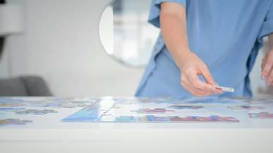 Person Completing A Jigsaw Puzzle