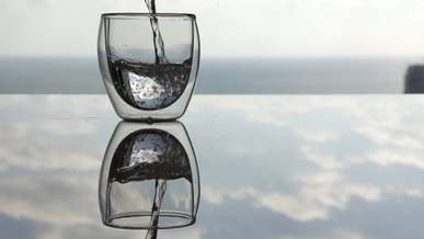 Pouring Water in Drinking Glass
