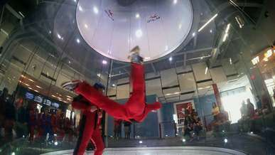 Skydivers Demonstrating the use of a Vertical Wind Tunnel