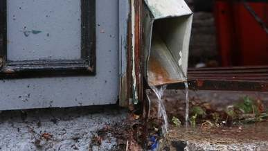 Water Flowing out of Gutter