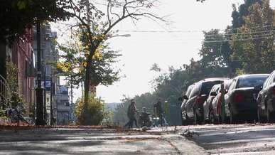 Bikers Driving on Street