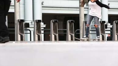 People Skateboarding Through a Park