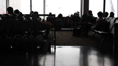 Silhouette Of People Waiting At The Airport