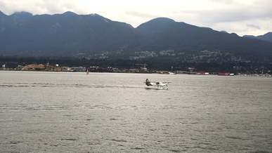 Seaplane Skims Across The Water Before Taking Off