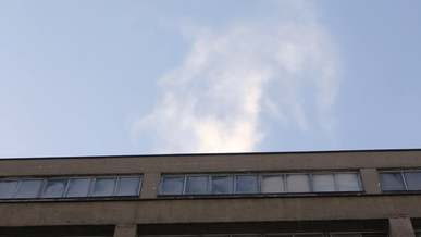 Time Lapse Of Clouds Over Building