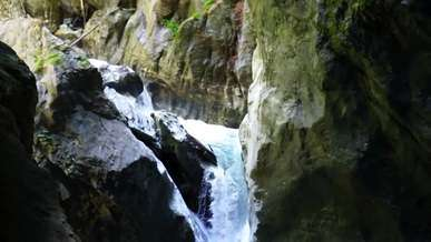 Small Waterfall Going Inside a Cave