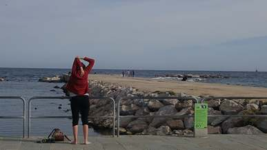 People Exercising By The Beach